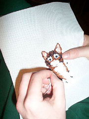 Cat in needlepoint; Actual size=180 pixels wide